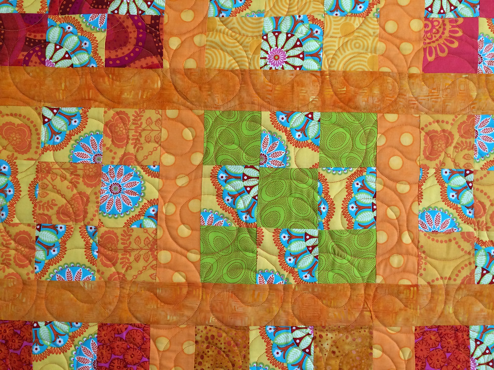 closeup of Nancy Thornton Kaffe Fassett quilting design of circles