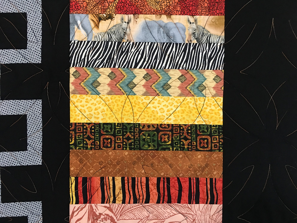 Another closeup of geometric quilting pattern on Out of Africa Quilt by Elon Webber