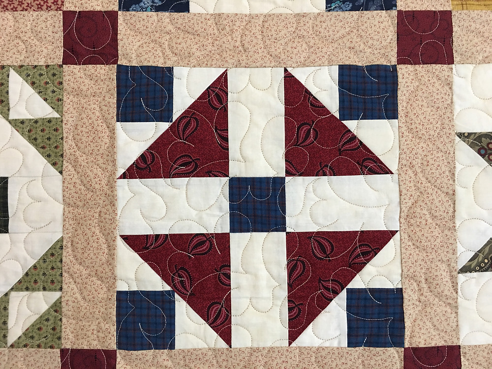 Feather quilting pattern on Civil War Block of the Month Quilt by Sandra Entjer