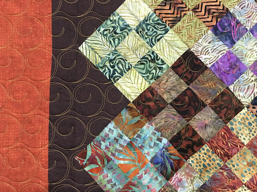 closeup of Sue Scrappy Nine Patch Quilt in Point