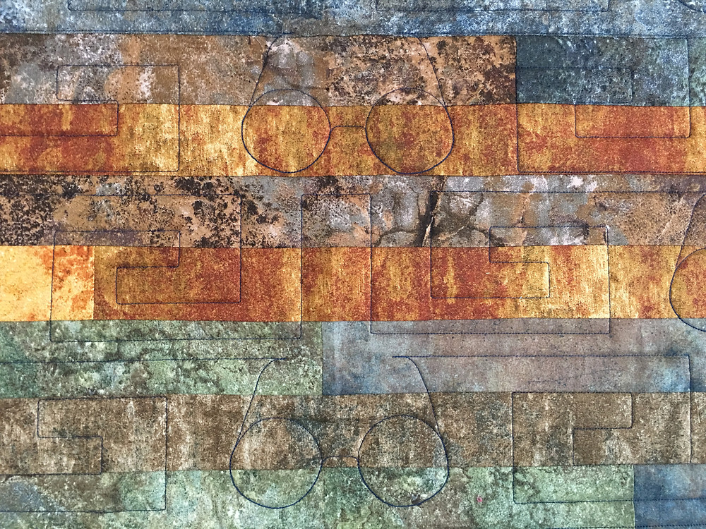 Quilting patters on Jelly Roll quilt by Lori Beckers