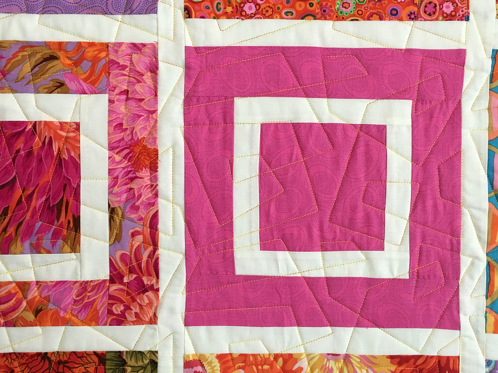 Geometric quilting pattern on colorful squares by Linda Shields