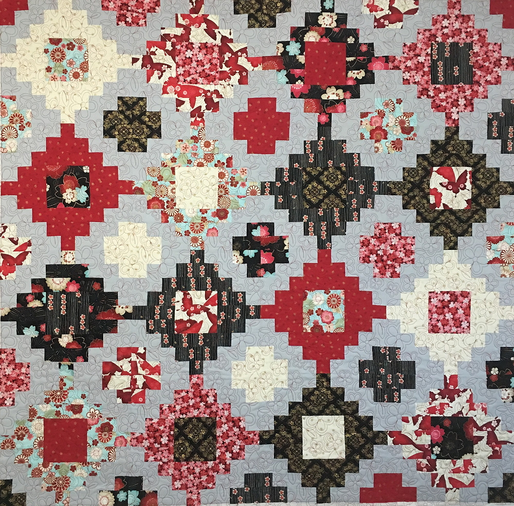 Stacked Red and Black Quilt by Cynthia Parra