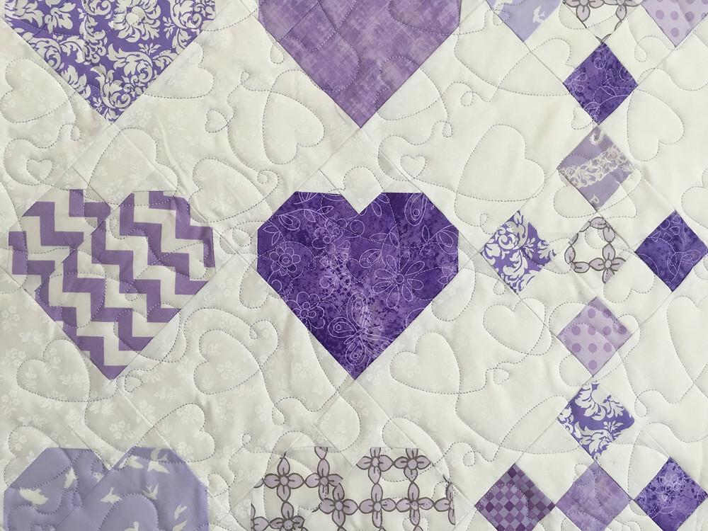 closeup of Lisa McCluer Purple Hearts Quilt