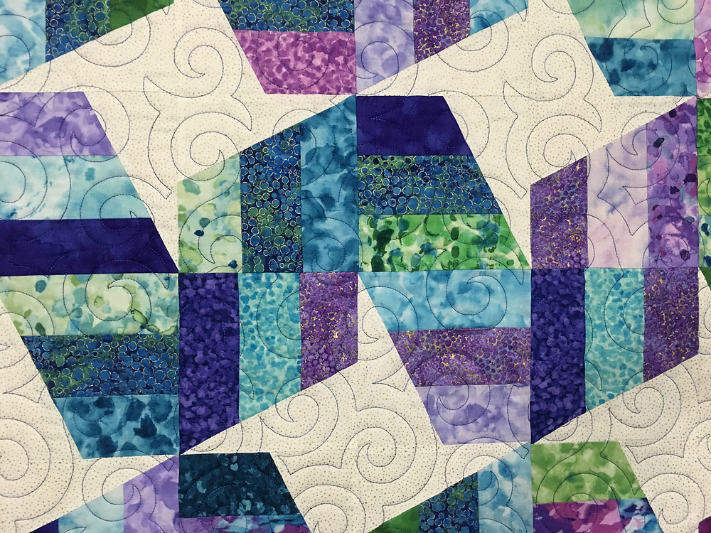 closeup of Cindy Unwind Quilt in shades of purple