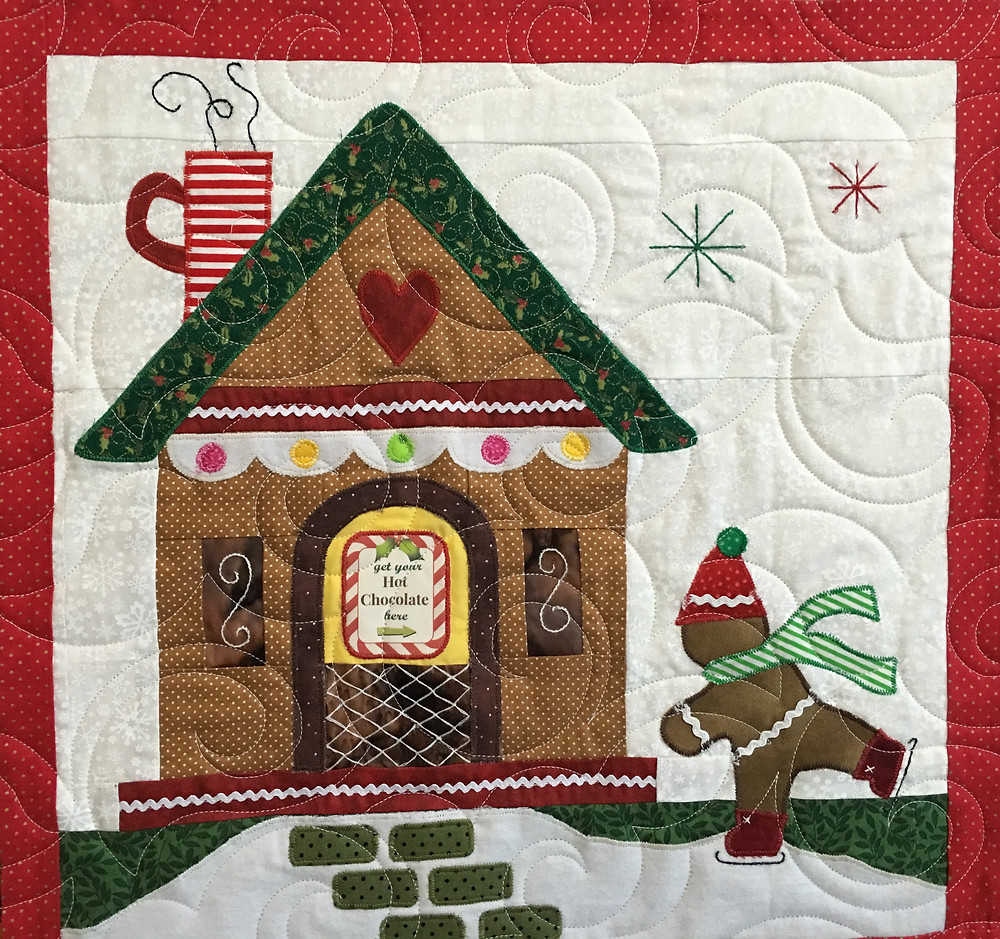 Swirls quilting pattern on Gingerbread Village quilt by Liz Zoch