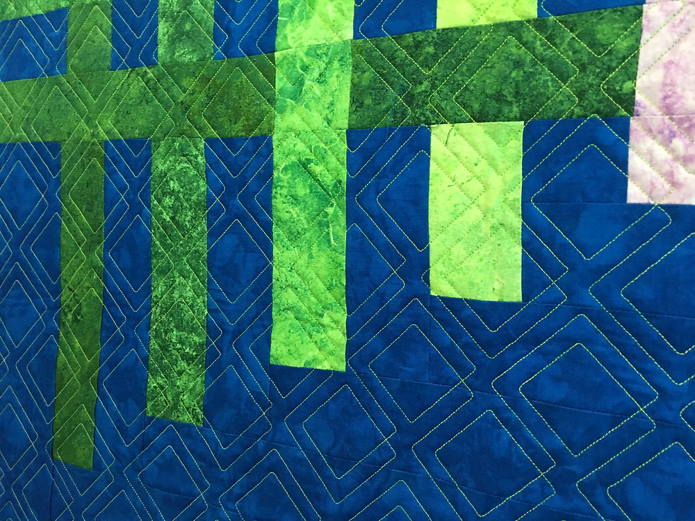Closeup of Laura's truly modern quilt with geometric quilting design
