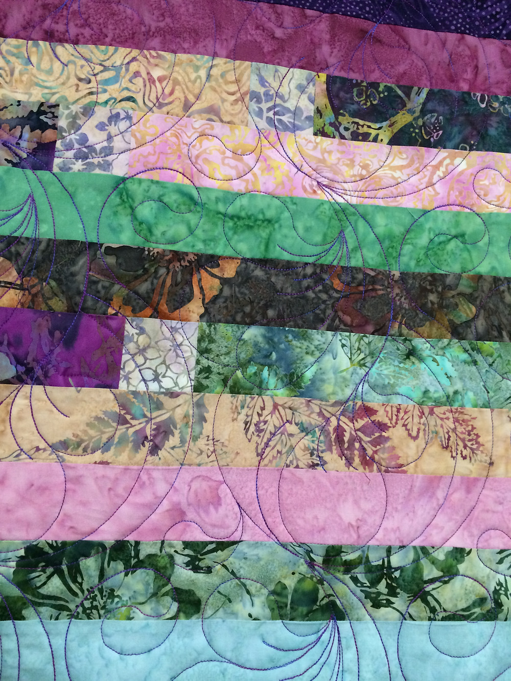 Feather quilting pattern on Bali Jelly Roll Quilt by Sally Krebs