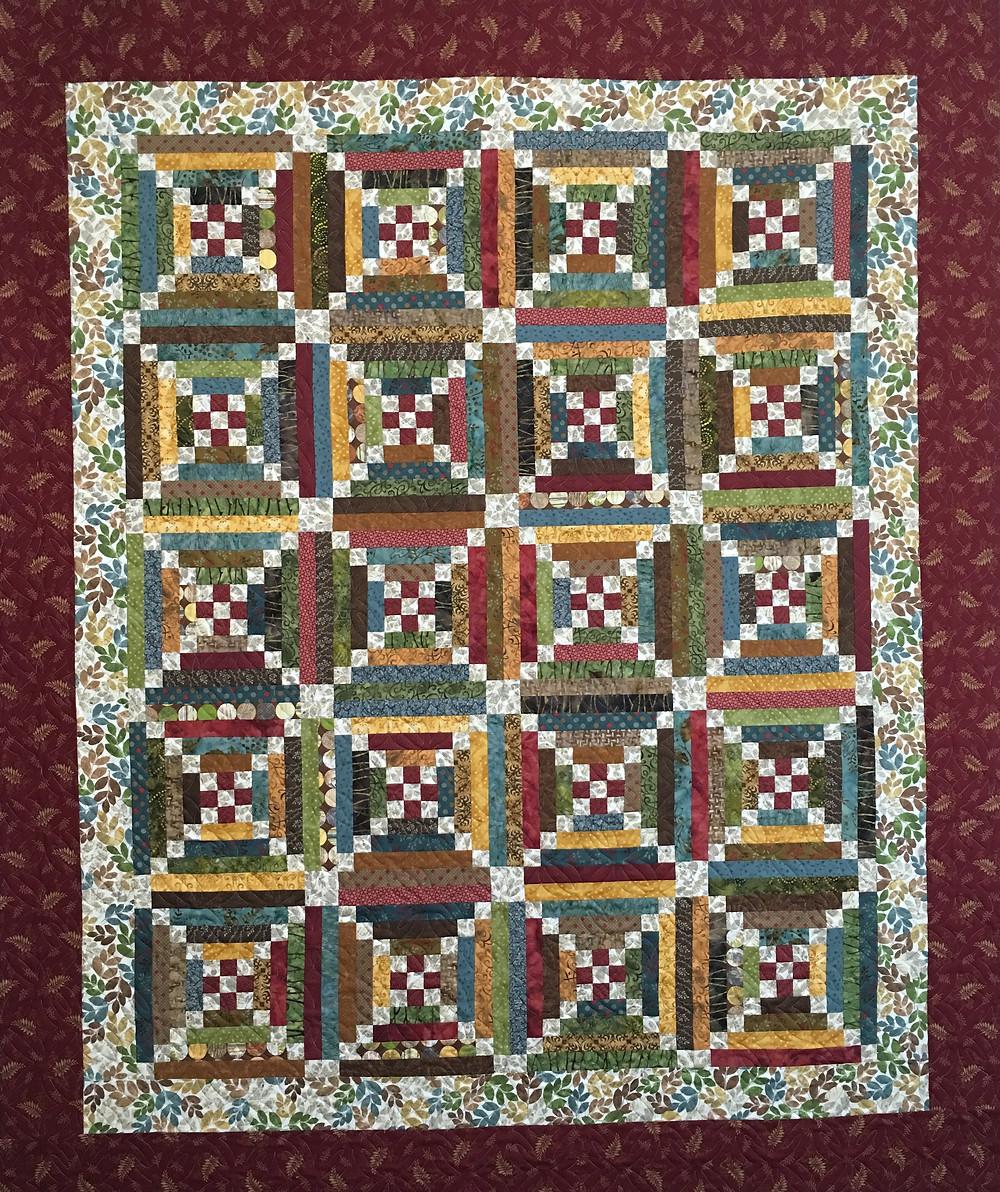 Terri's Wall hanging quilt in batik fabrics