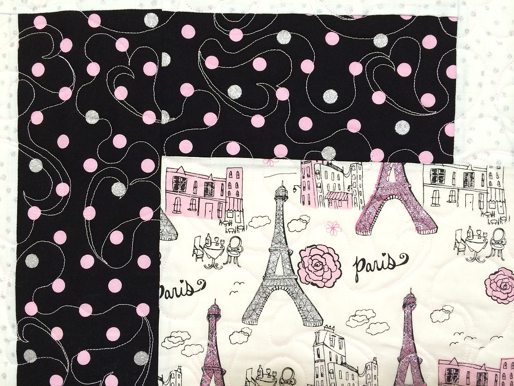 closeup of little girl Paris quilt panel fabric