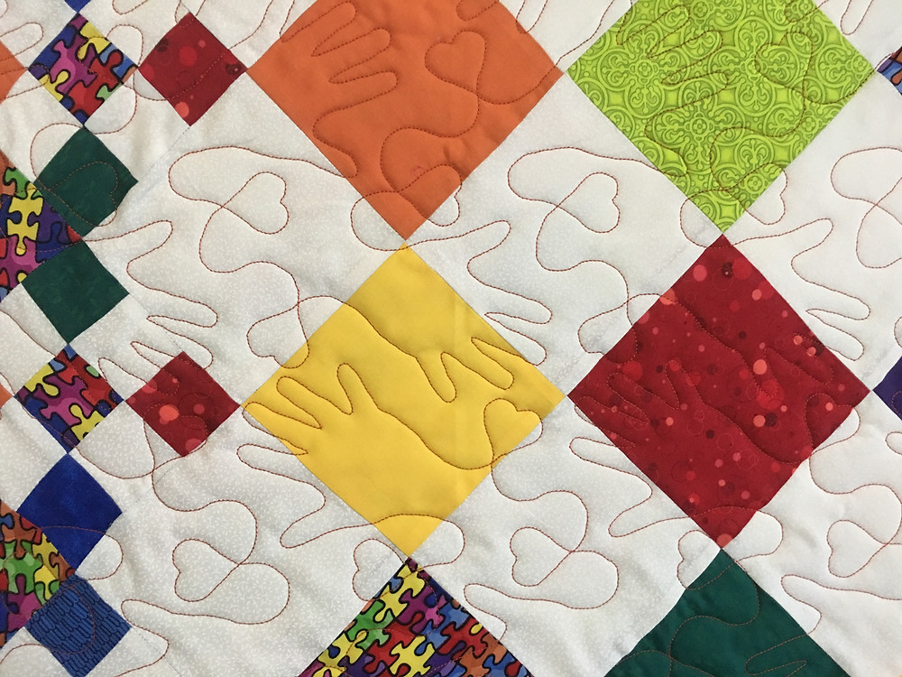 Little Hands Quilting Pattern on Diamond Patchwork Quilt by Roxane Darnell