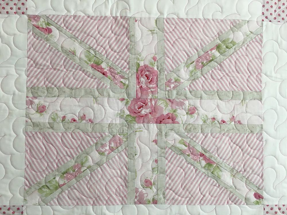 Flower quilting pattern on Baby Brit Baby Quilt by Karen Natale