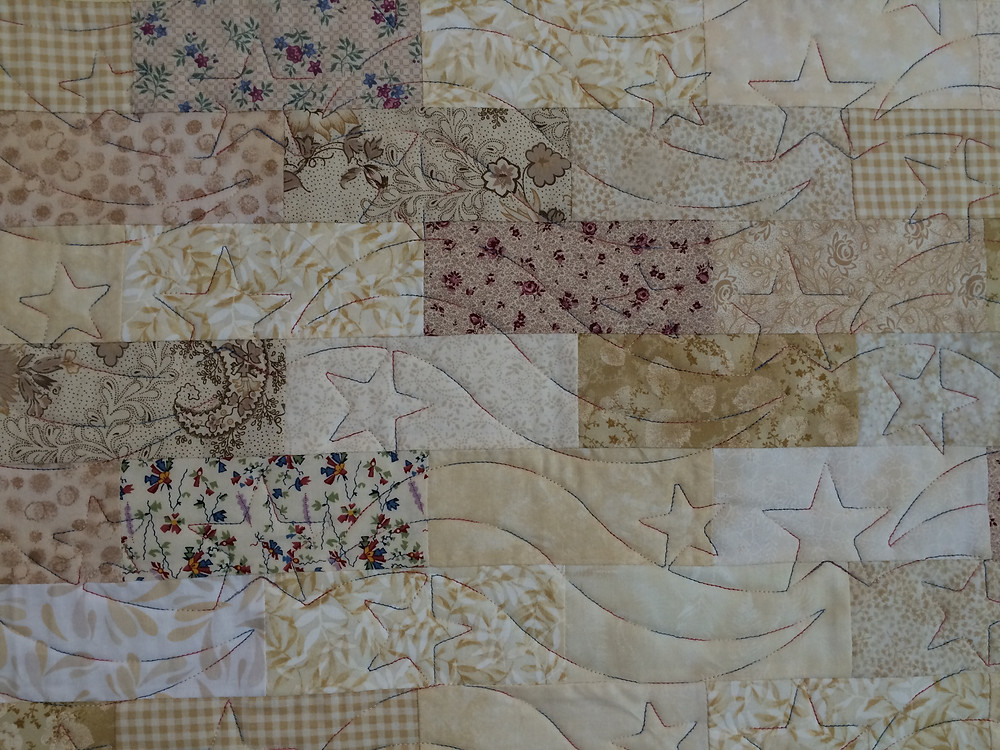 Texas Flag quilt with stars and ribbons quilting design