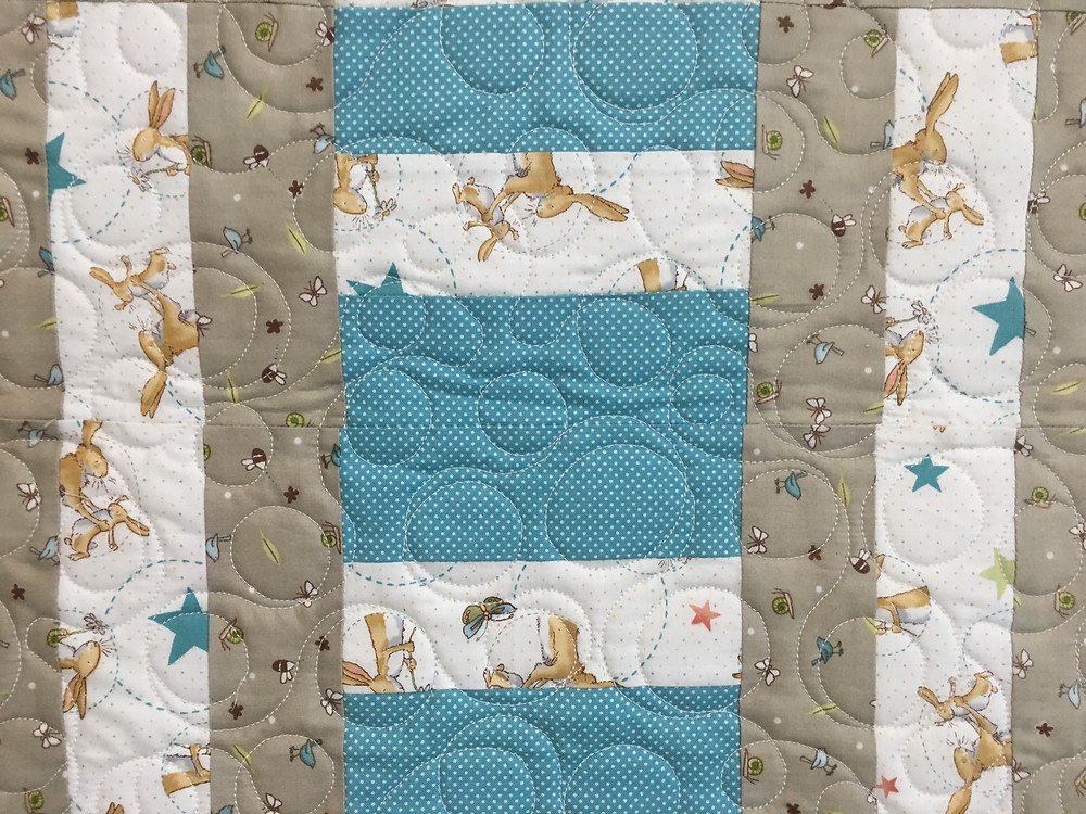 Circle Quilting Pattern on Daddy Rabbit Baby quilt by Jill Seward