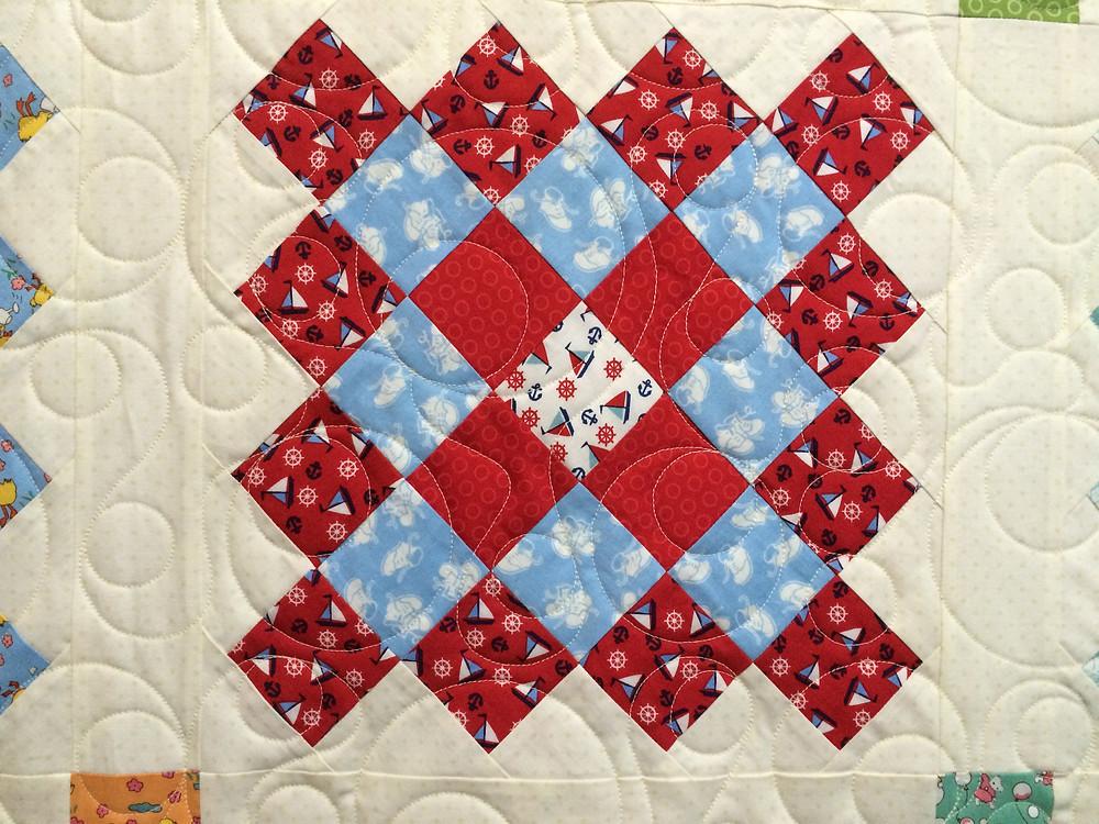 closeup of quilting design on great granny squares quilt