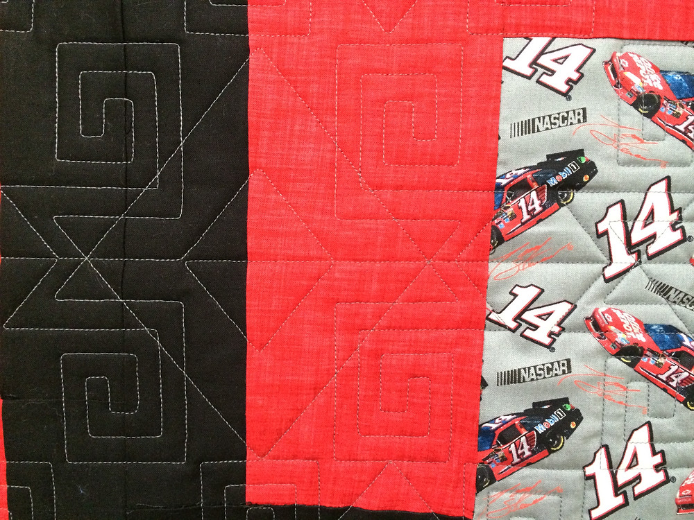 Tony Stewart Nascar red and black quilt with geometric quilting design