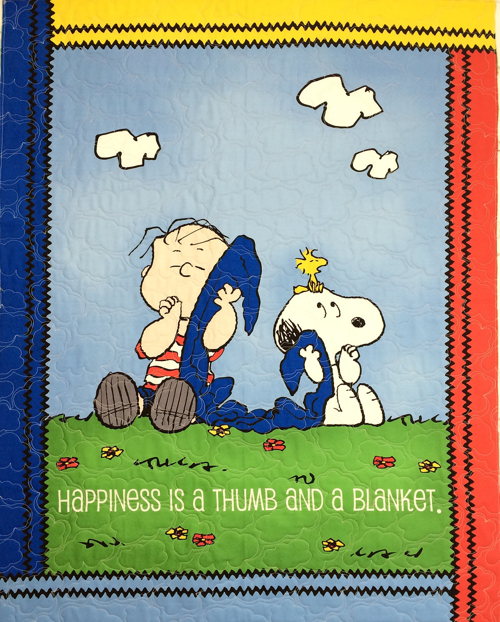 Snoopy and Lunus quilt with bright colored  panels