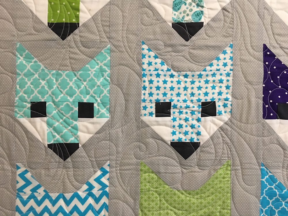 Feather quilting pattern of Fox Faces quilt by Jocelyn Robinson