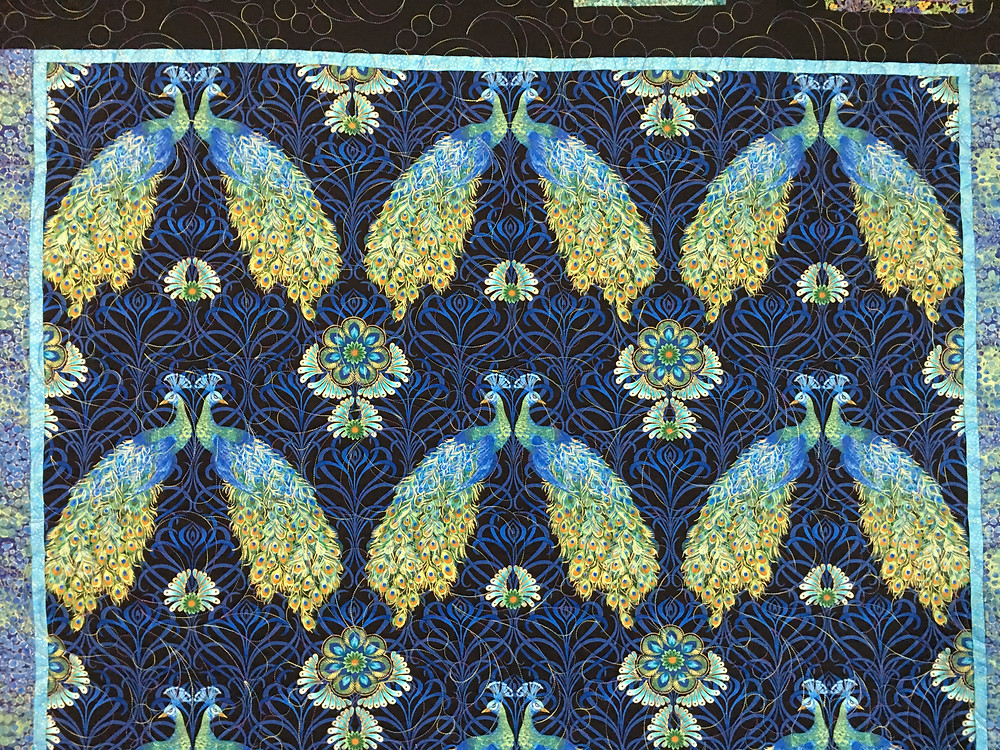 Close up of A Collection of Peacocks Quilt by Peggy Krebs