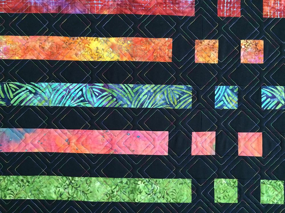 closeup of morse code quilt in bight colors