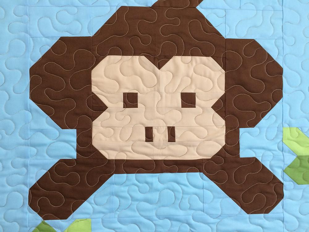 closeup of Kimberly Jolly Monkey Baby Quilt
