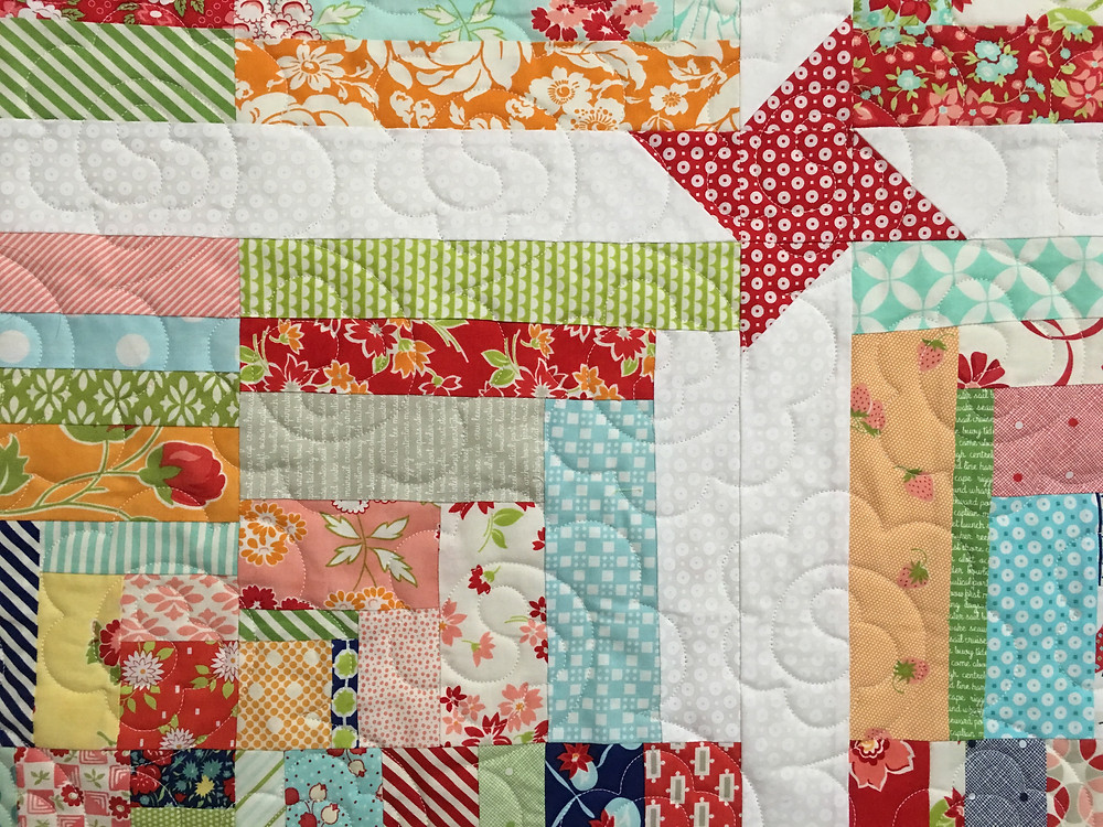 another closeup of the quilting on Deb Scrappy Christmas Quilt