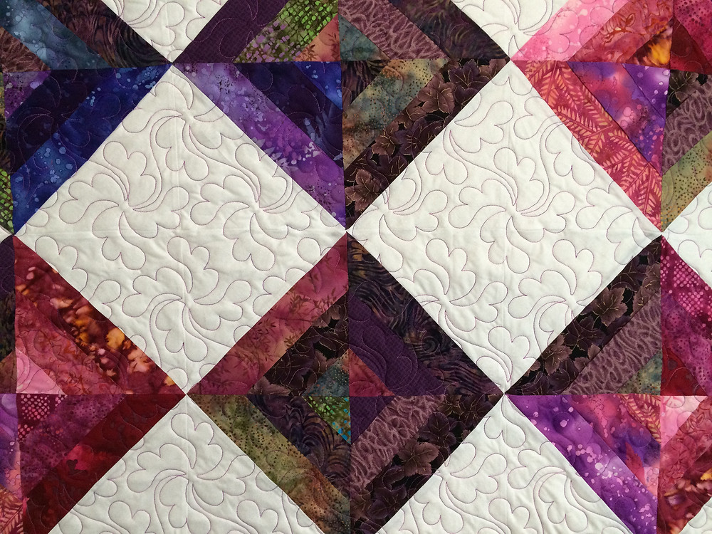 Close up of Sue Antle Purple and White Quilt