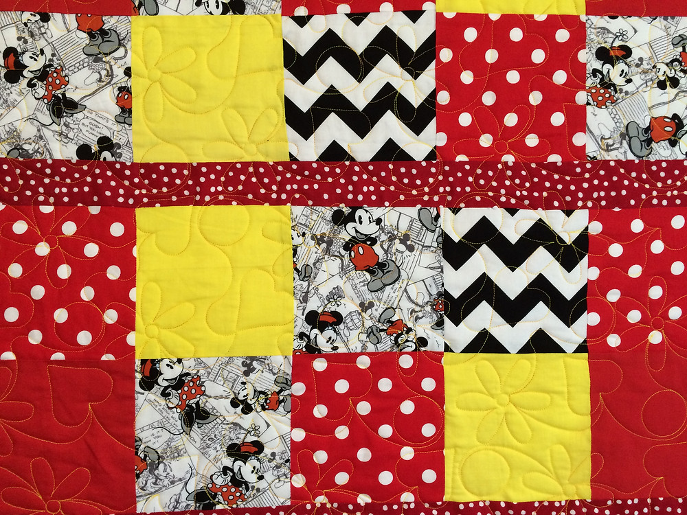 closeup of minnie mouse and micky mouse print fabrics
