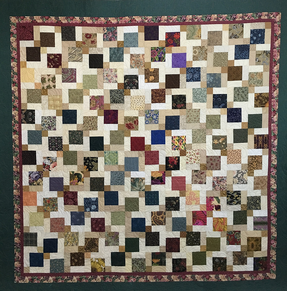 Disappearing 9 Patch quilt made by Sally Krebs