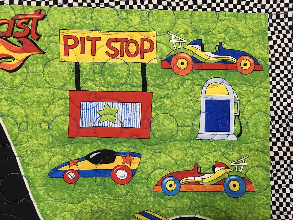 Another Closeup of Jeri Couthen Racing Car Quilt
