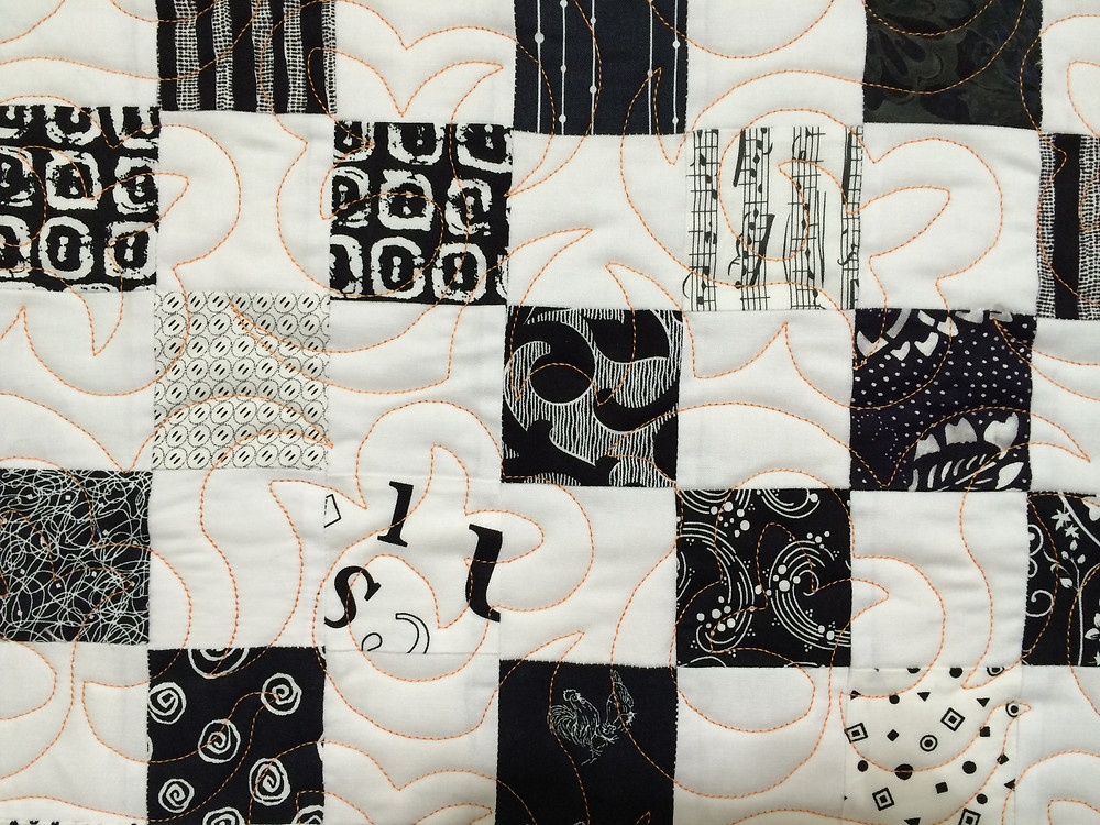 small squares of black and white with quilting design