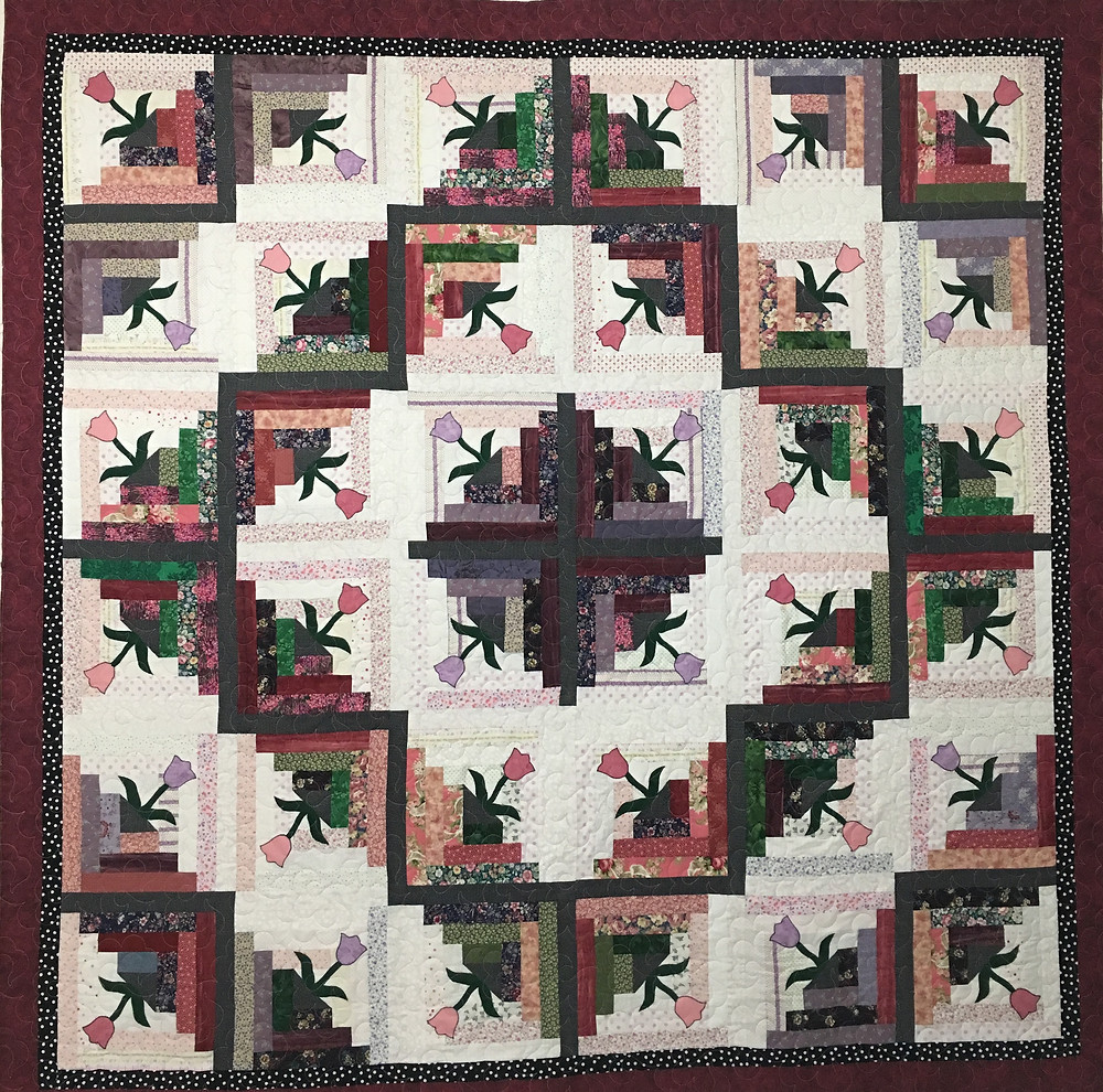 Log Cabin with Tulips Quilt by Dolores Steward