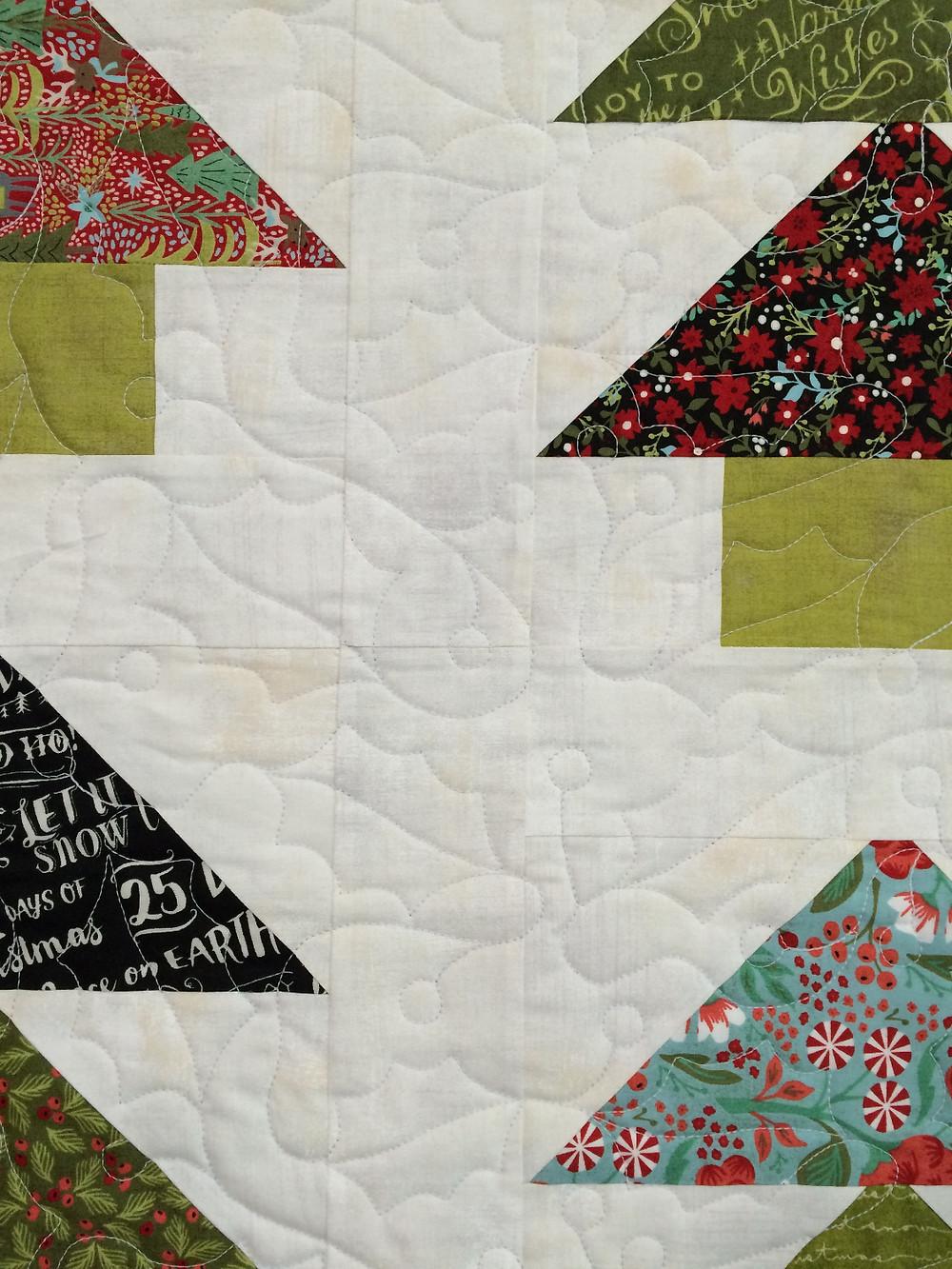 closeup of Deborah Hawkins Festive Forest Quilt