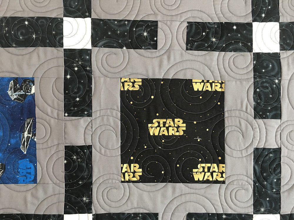 Another Close up of Circles Quilting Pattern on Framed Star Wars Quilt by Janelle Morillo