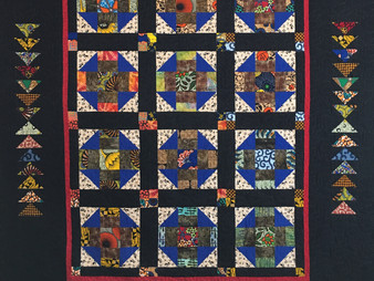 Evelyn Edinburg African Fabric on Churn Dash and Flying Geese Quilt
