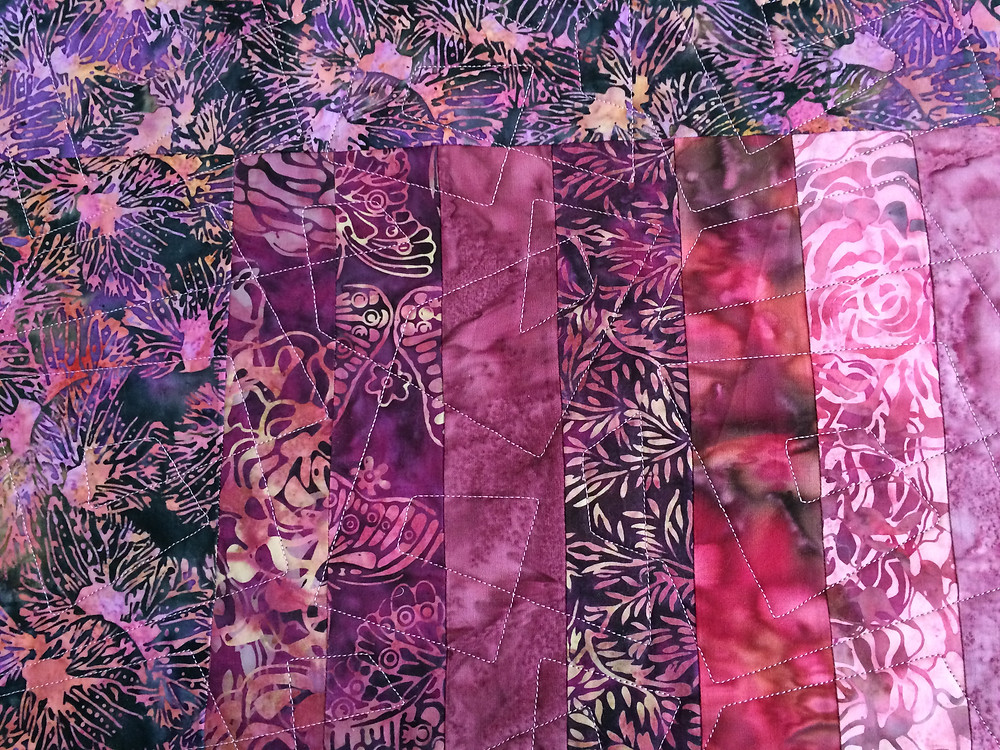 Close up of Stella Siwinski Pink Batiks Quilt