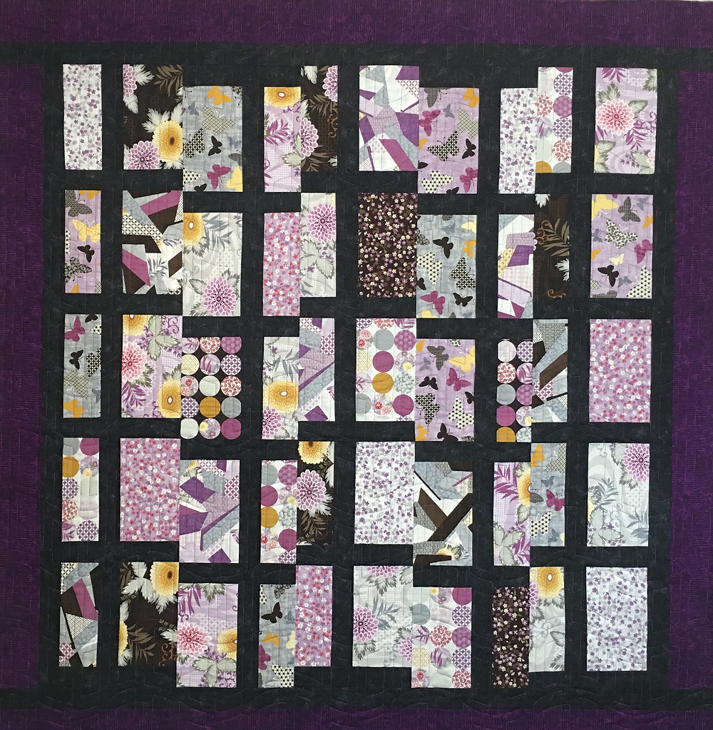 Cindy T Intersection Quilt with purples and black fabric