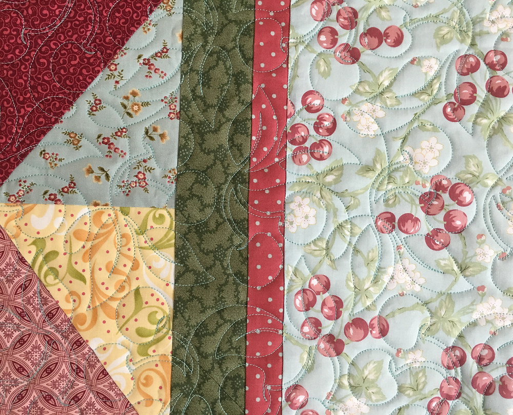 Cherries in bunches quilting pattern on Diamonds in Squares quilt by Lori Beckers