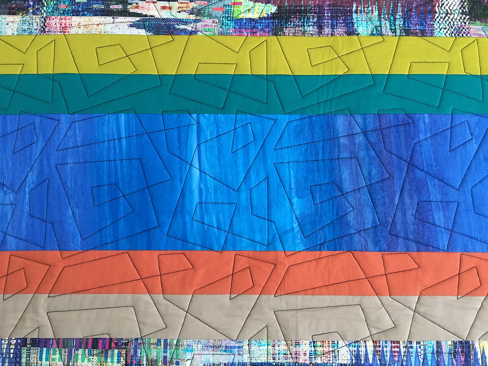 Geometric Quilting Pattern on City Scapes quilt by Sally Krebs