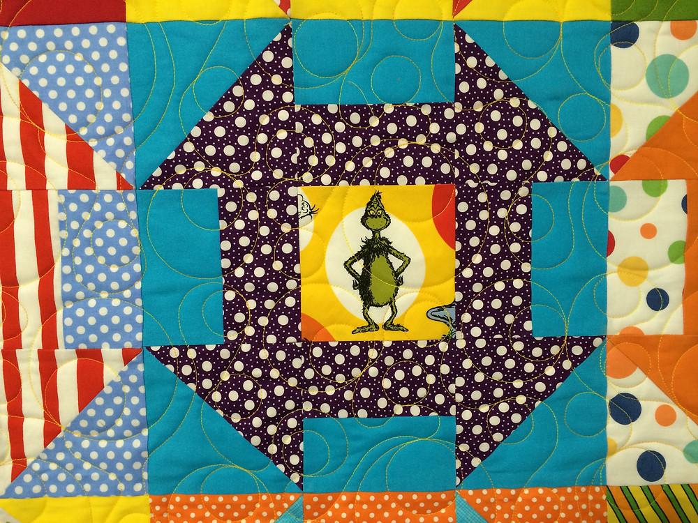 closeup of Mister Grinch motif on Doctor Seuss quilt