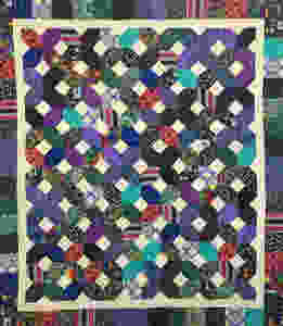 X and O Quilt by Sandy Benson