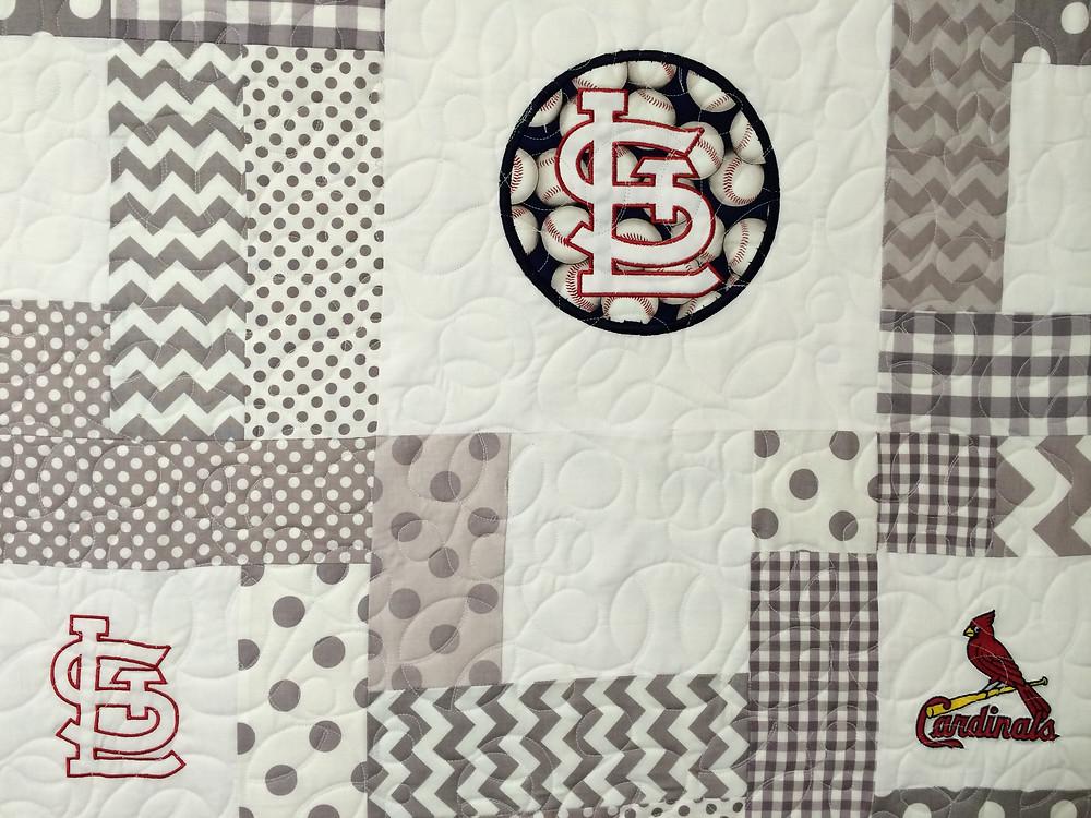 closeup of baseball quilting pattern on St Louis Cardinal quilt