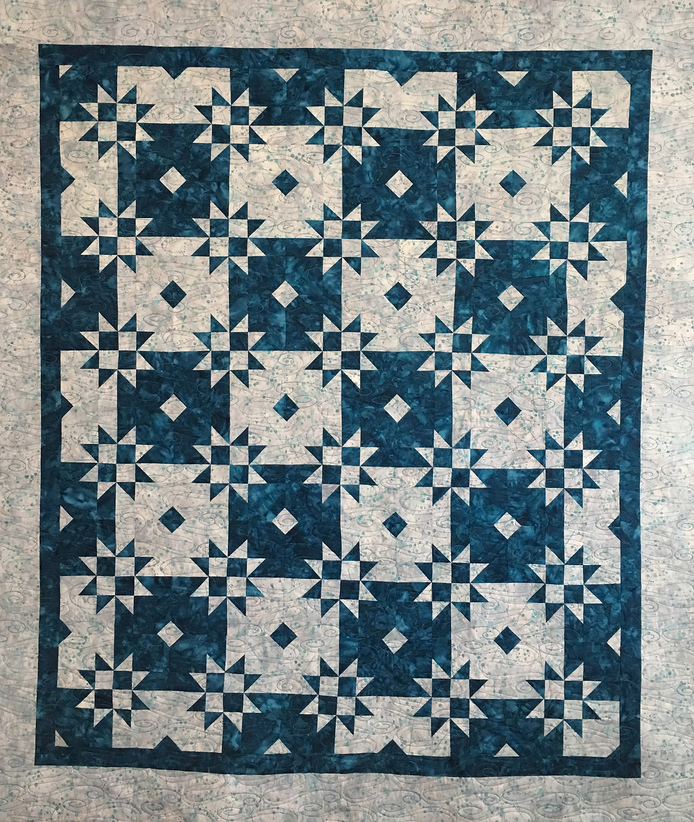 Blue and White Star Quilt by Linda Betncourt