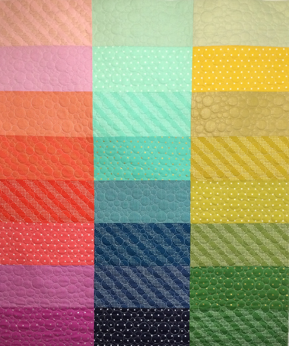color gradation quilt in rainbow colors