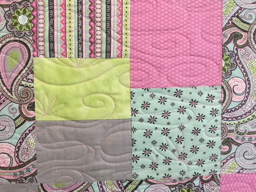 Swirls quilting pattern on Paisley in Pinks quilt by Joan Salesman