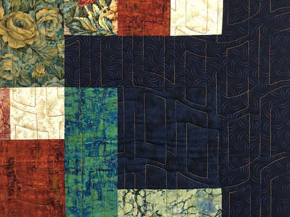 Geometric Quilting Pattern on Yellow Brick Road Quilt by Michelle Bonnes