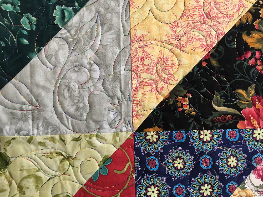 Floral Quilting Pattern on Fiore Diamante Quilt by Sally Krebs