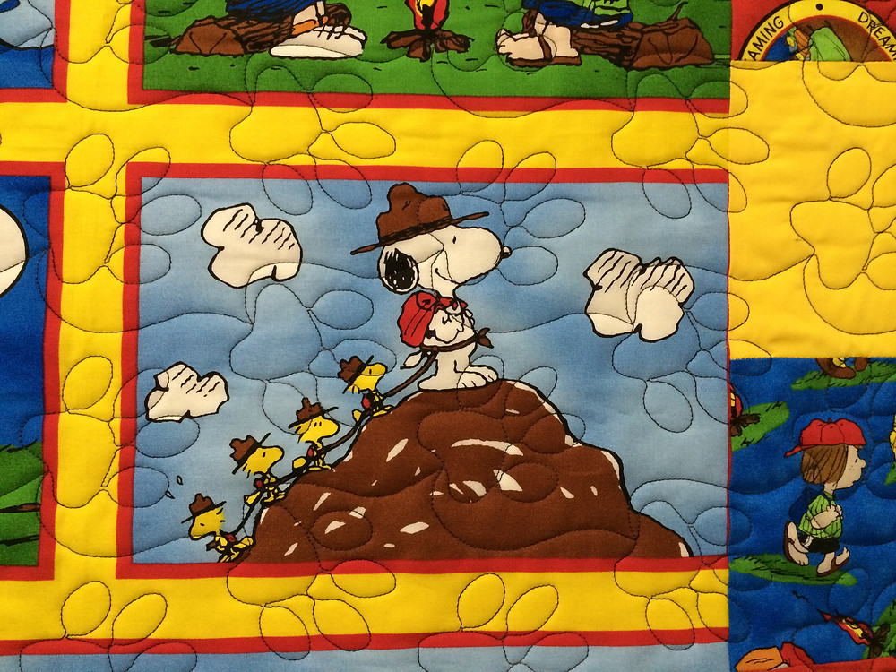 Paw Prints quilting pattern on Peanuts Quilt by Kelly Sears