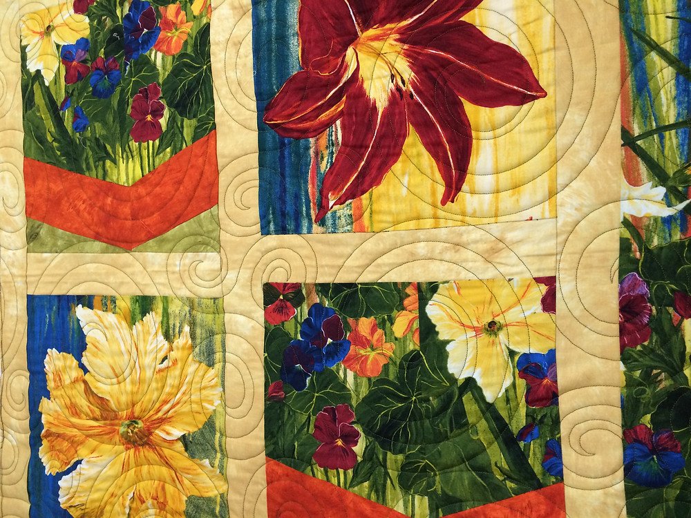 large floral panel quilt with swirl quilting