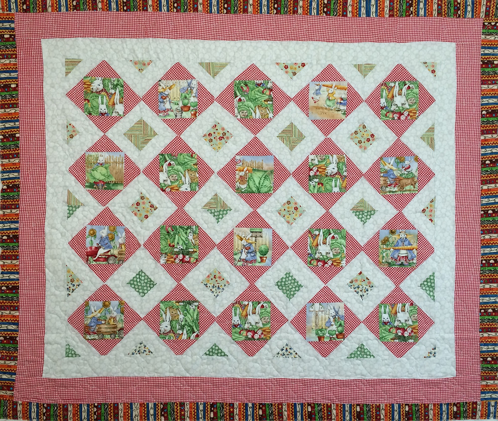 Judi Bunnies prints in red and white quilt